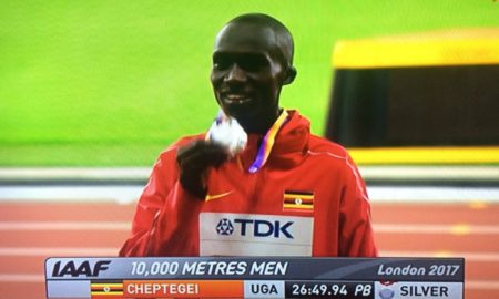 Cheptegei shows the solver medal he won at the IAAF London championships in London