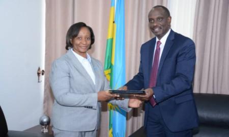 Dr K. Mwinga, WHO Representative (left), and Dr R. Sezibera, Minister