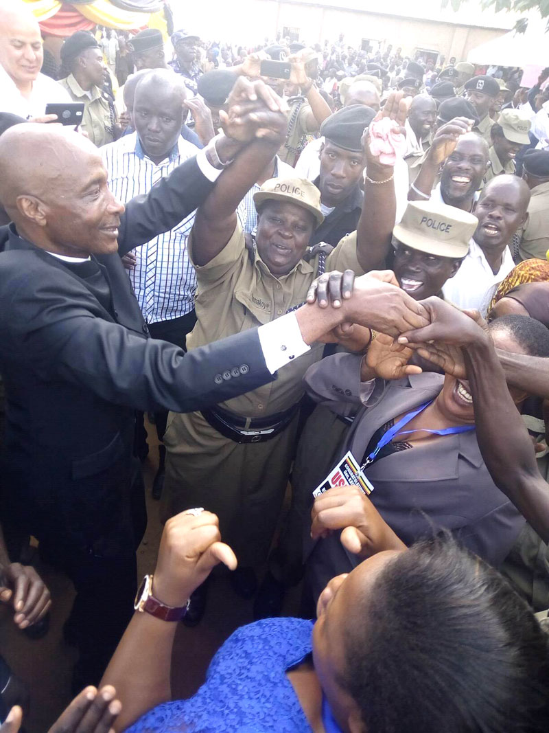 Gen Kayihura celebrates his re-appointment with Mbale residents on Sunday// Denis Oduut.