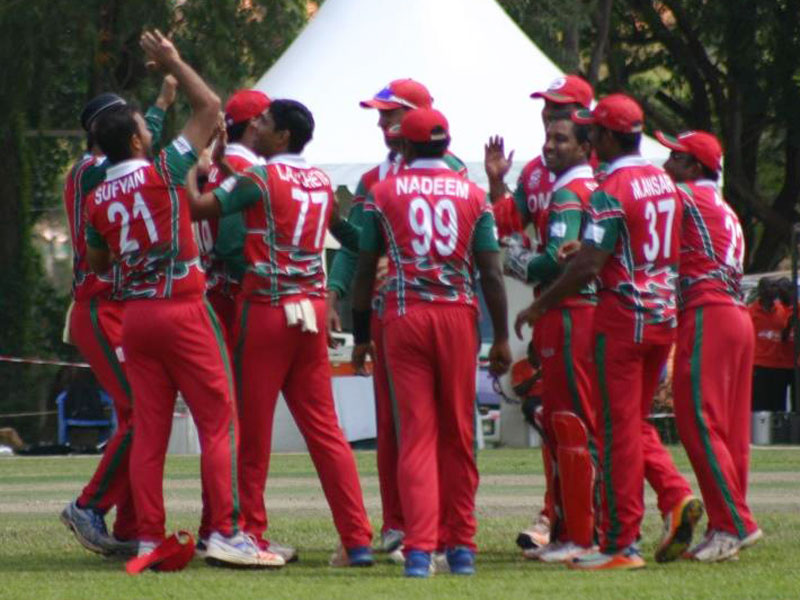 Omani players celebrate a wicket// Alvin Bagaya.
