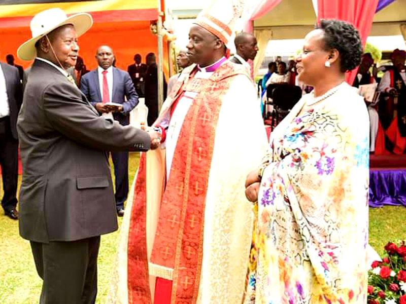 President Museveni congratulates Bishop Twinomujuni.