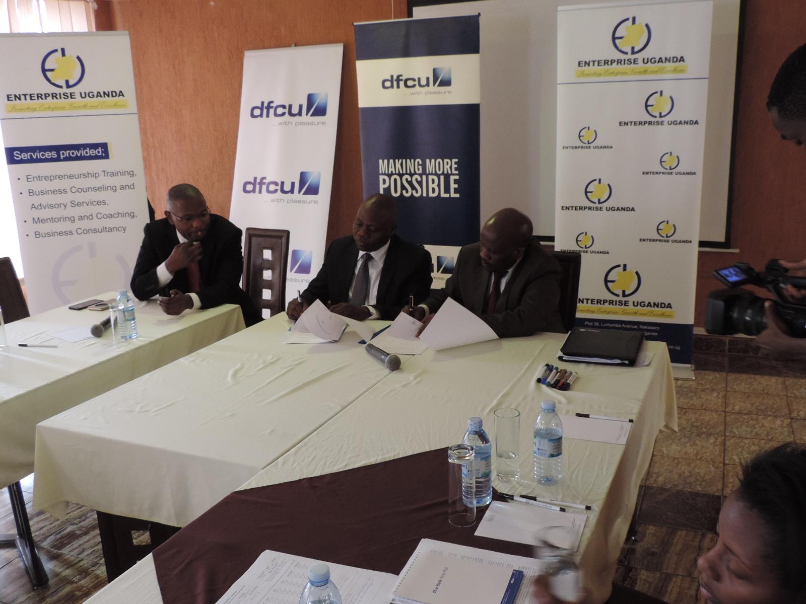 dfcu and Enterprise Uganda officials address the press