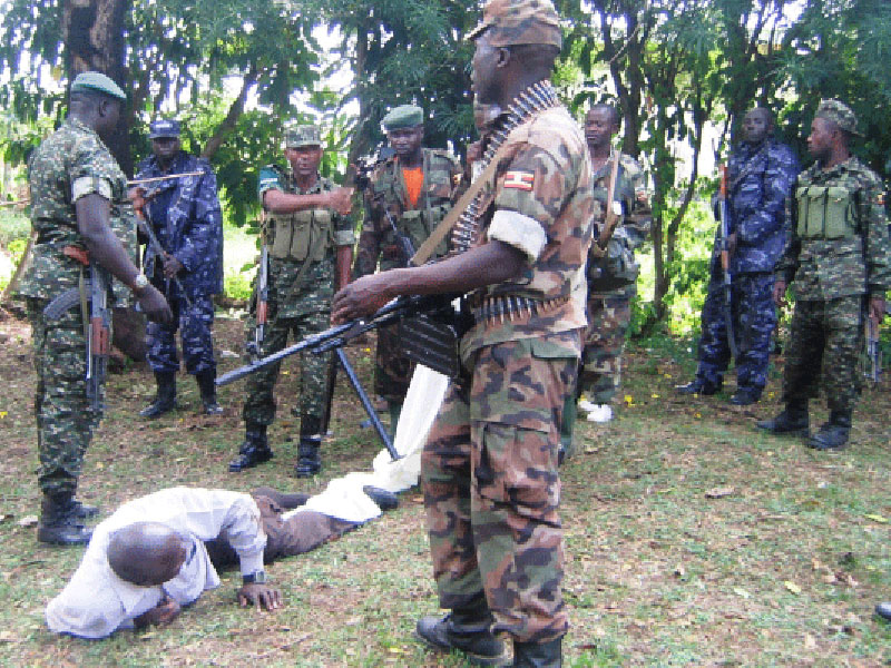 Police and Military officers torture a civilian in Kasese.