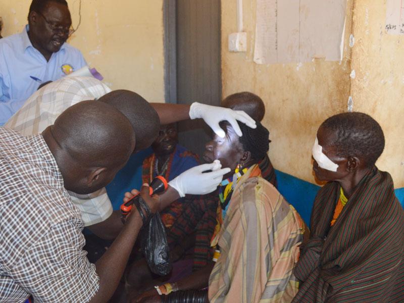 Lions Clubs of Uganda affiliated medics examine trachoma patients. Courtesy.