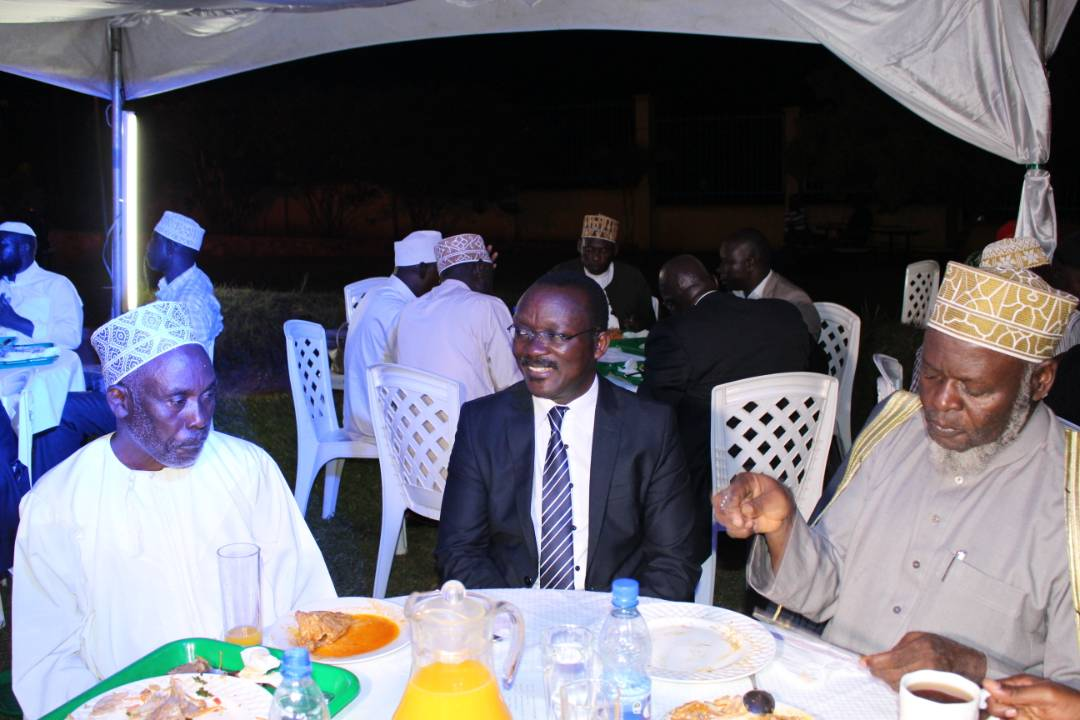 Mufti Mubajje shares a meal with NCSC officials and other guests at the Iftar event yesterday