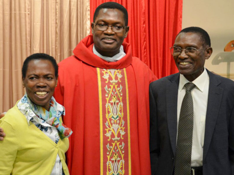 Fr Nsambu with his parents.