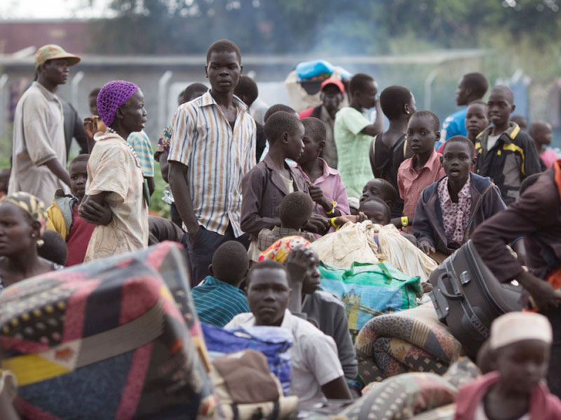 South Sudanese refugees help push a car in Soroti last year.