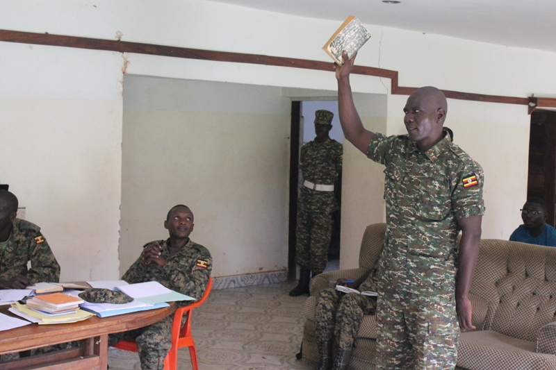 Private Samuel Kidega  taking oath before Military court martial at 4th Division Barrack in Gulu town today