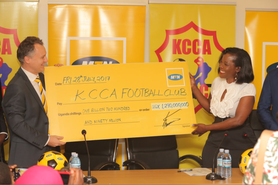 MTN Chief Executive Officer Wim Vanhelleputte (left) hands over a dummy cheque to KCCA Executive Director Jennifer Musisi. Courtesy photo