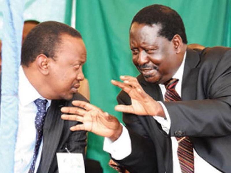 Uhuru Kenyatta (left) and Raila Odinga share a light moment at a past event.