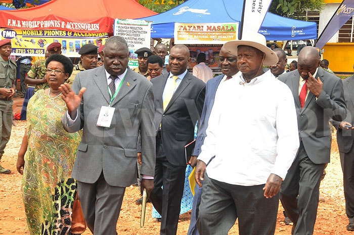 President Museveni (right) arrives for the opening of the 24th Edition of the Jinja Agriculture Show last year. Courtesy photo