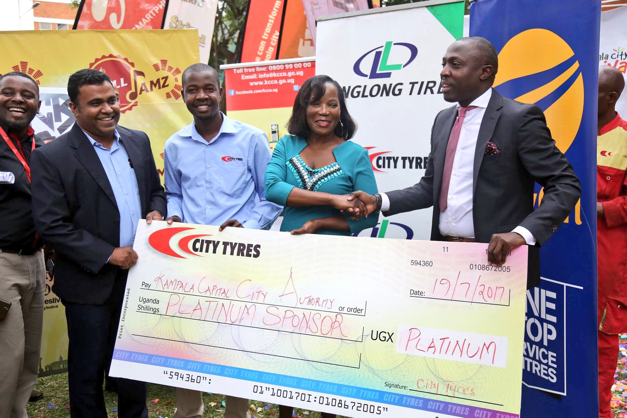 KCCA executive director Jennifer Musisi displays a dummy cheque at the launch of this year's city carnival. Courtesy photo