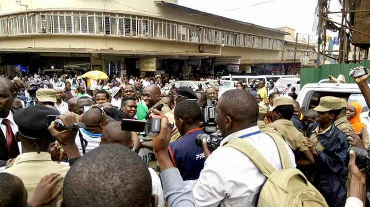Nobert Mao is sandwitched by supporters and police personnel shortly before his arrest. Courtesy photo.