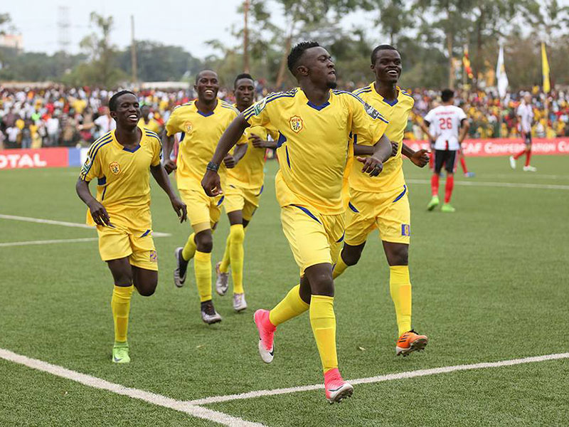 Sadam Juma leads his team mates in celebrating KCCA's second goal.
