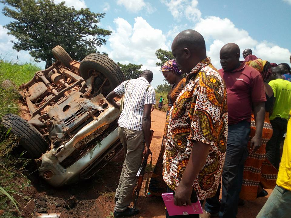 Secuirty operatives inspect the overturned vehicle along the road. Courtesy photo.