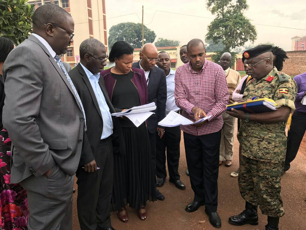 ICT minister Frank Tumwebaze (2nd right) with a team from the UPDF Engineering Brigade, ICT ministry and UCC inspect the site. Courtesy photo.