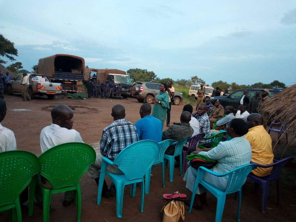 Lands minister Amongi (centre, in blue dress) at the camp in Payot village from where the government is running the Amuru land survey operations. Photo by Willy Chowoo.