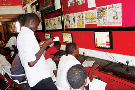 Young men in an unnamed betting house somewhere in central Uganda. Courtesy picture.