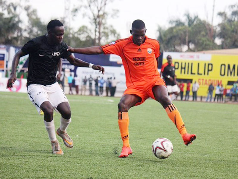 Bigala (left) closes in on Soana's Willy Kavuma during a league match last season.