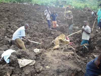 Locals dig through the rubble in search for missing relatives after the October 11 mudslides in Bududa. Makerere University has dispatch a team to Bududa under the Aiding Bududa Communities (ABC) Initiative (FILE PHOTO)