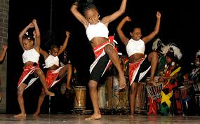 Children dancing to traditional music.