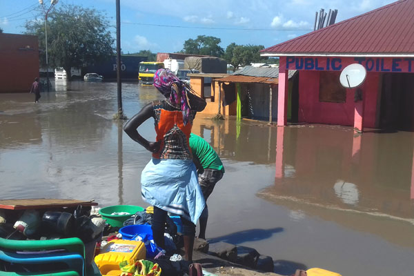 Residents of Elegu Trading Centre in Atiak Sub-county, Amuru District ponder their next move after a flood submerged several homes and business premises on Tuesday