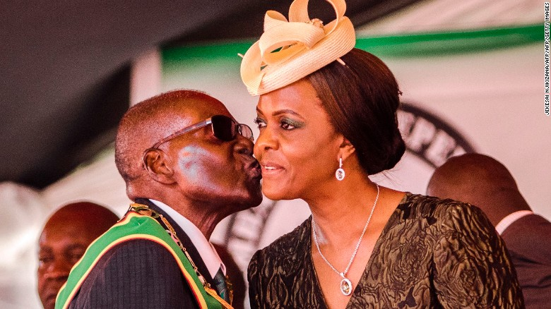 President Mugabe kisses his wife during Zimbabwe's 37th Independence Day celebrations in April. CNN photo.