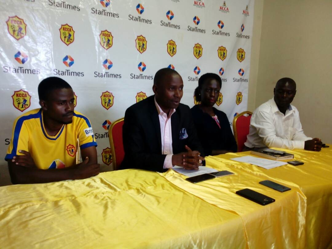 KCCA FC chairman Aggry Ashaba (2nd left) and club CEO Josephin Namukisa (2nd right) addressing journalists at the press conferance at the Star Times stadium. Extream left and right are some of the fans who have already purches the tickets.
