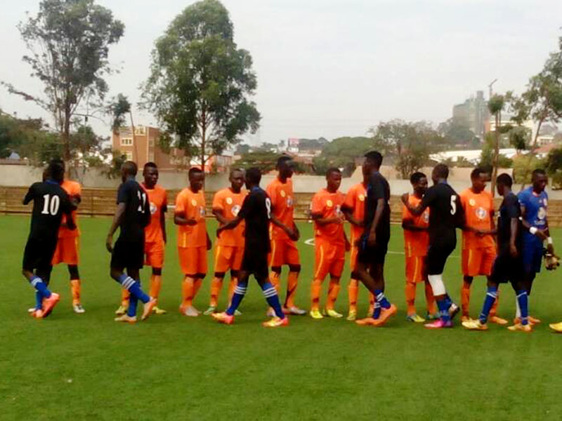 The players greet one another before the start of the friendly match. Shaban Lubega.