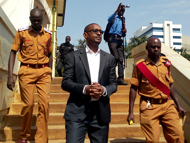 Kanyamunyu is escorted back to Luzira from High Court in Kampala yesterday. Badru Afunadalu.