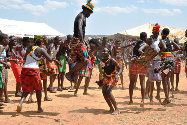 Youth take part in a traditional dance in Karamoja. N