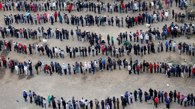 Long queues snaking out of a polling station in Nairobi. Pollsters predict massive voter turn-out. BBC  photo,
