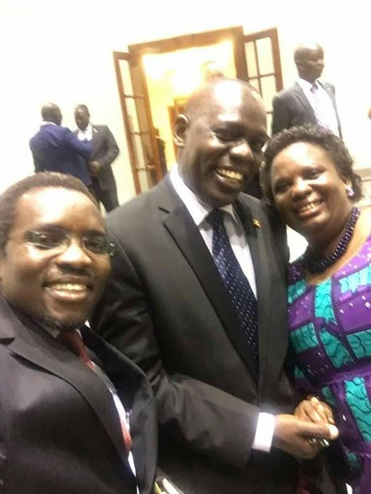 Kilak South Mp Gilbert Olanya and Land Minister Minister Betty Amongi hanging while smiling after the meeting in state house Entebbe