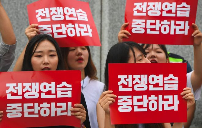 """South Korean protesters held up placards reading """"Stop war exercise"""" near the US embassy in Seoul on Monday"""