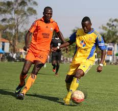 Brian Majwega dribbles past a defender during a past KCCA FC encounter. Courtesy photo.