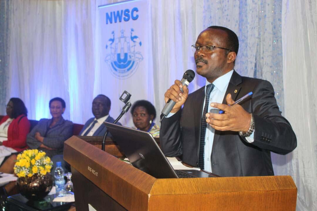 Eng. Dr. Mugisha speaking at NW&SC's 4th Customer Connect Baraza in Kampala. PML Daily photo.