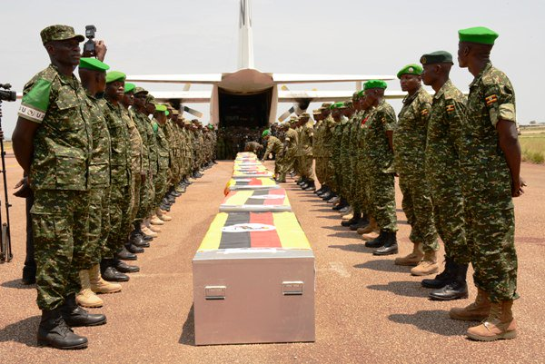 Soldiers pay respects to the slain soldiers at Entebbe. Courtesy photo