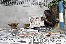A city dweller runs through the press reporting following the  2005 referendum on political systems.