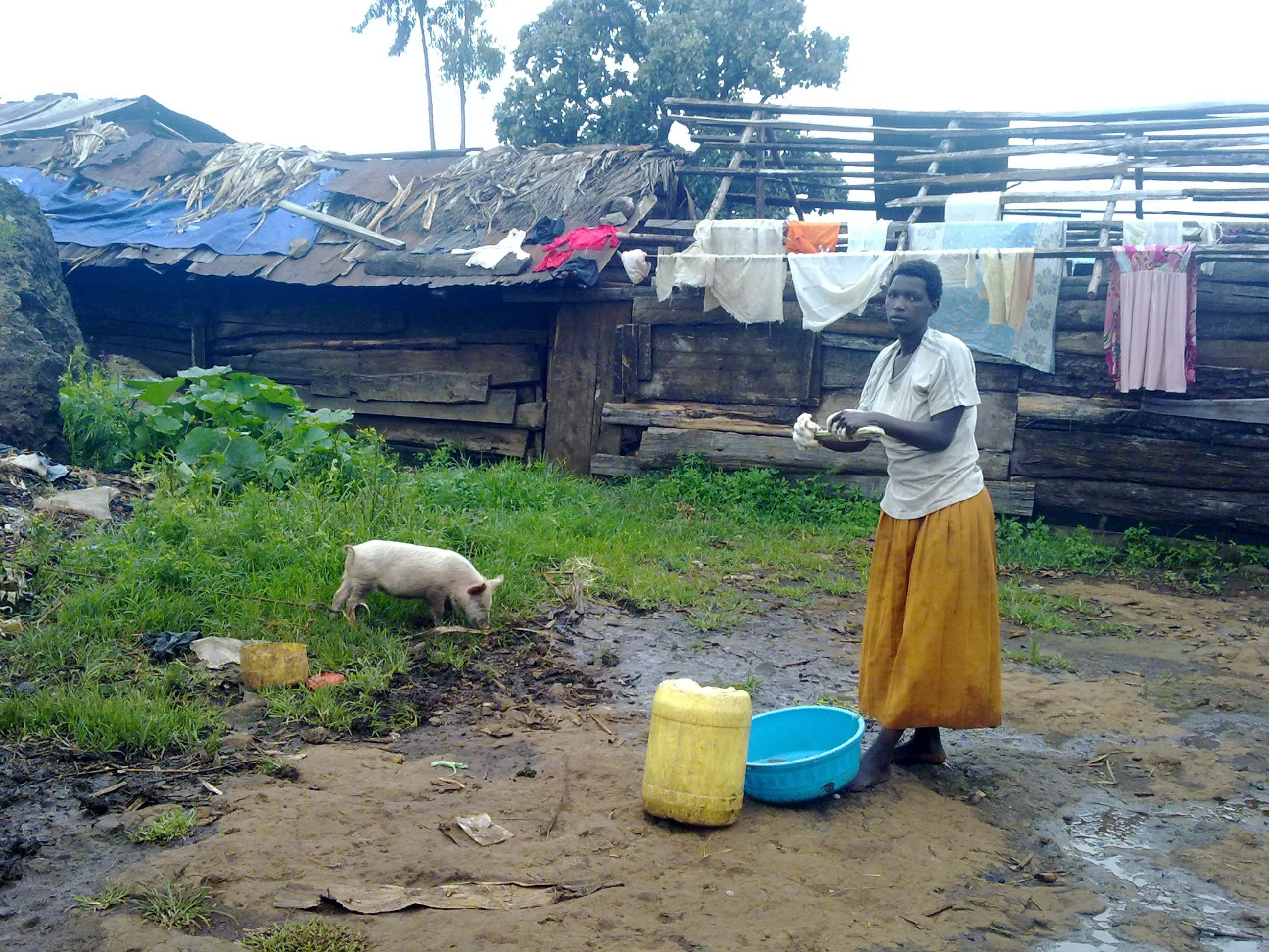 Chemutai washes here clothes at the Rwanda camp in Kween District. Photo by Daudi Nana.