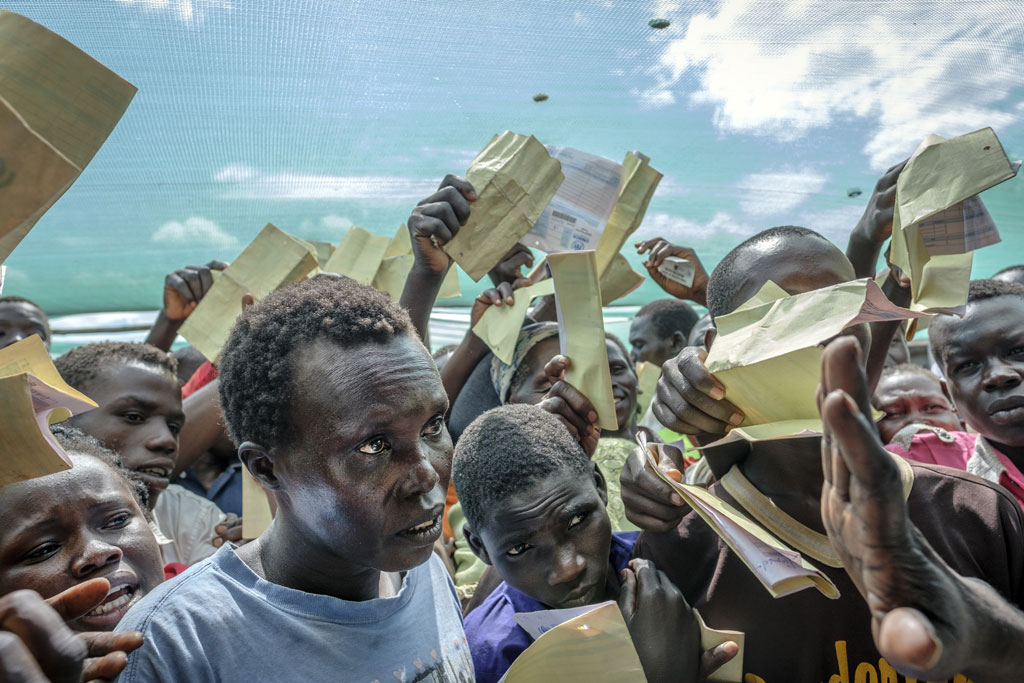 South Sudanese refugees demand to be registered at Imvepi reception centre in Arua district in Northern Uganda. UN news centre picture.