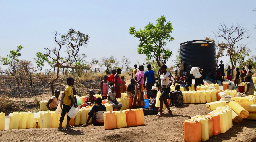 South Sudanese refugees queue up for water in Bidi Bidi settlement, West Nile. Agency photo.