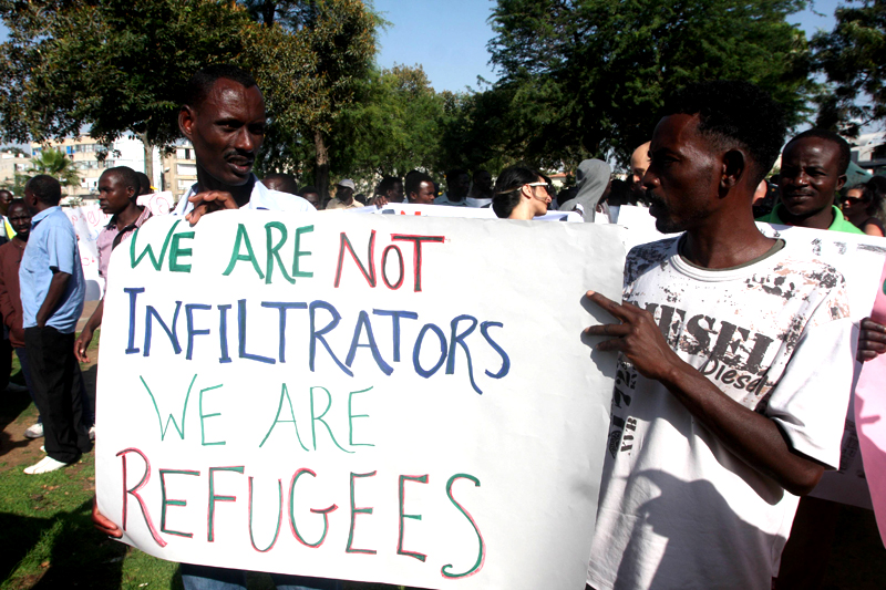 African refugees protesting mistreatment at a rally in Israel recently