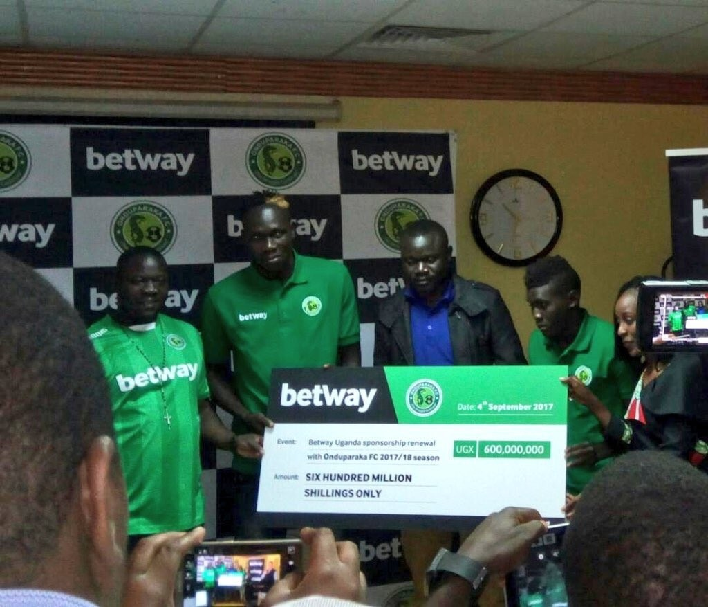 Some of Onduparaka players and stuff recieving the bumper cheque at hotel Africana