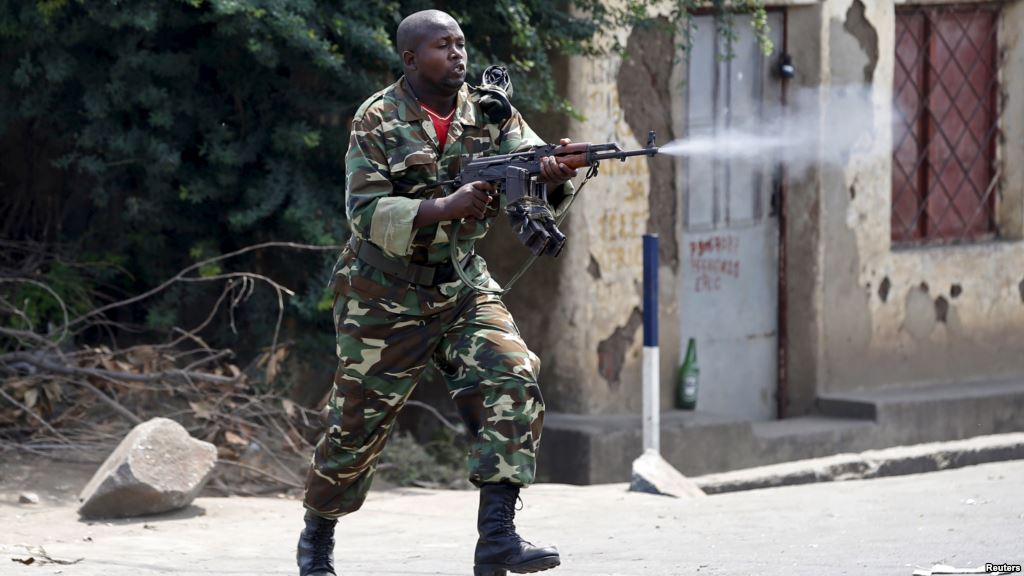 A Burundian soldier opens fire on the streets of Bujumbura in 2015.