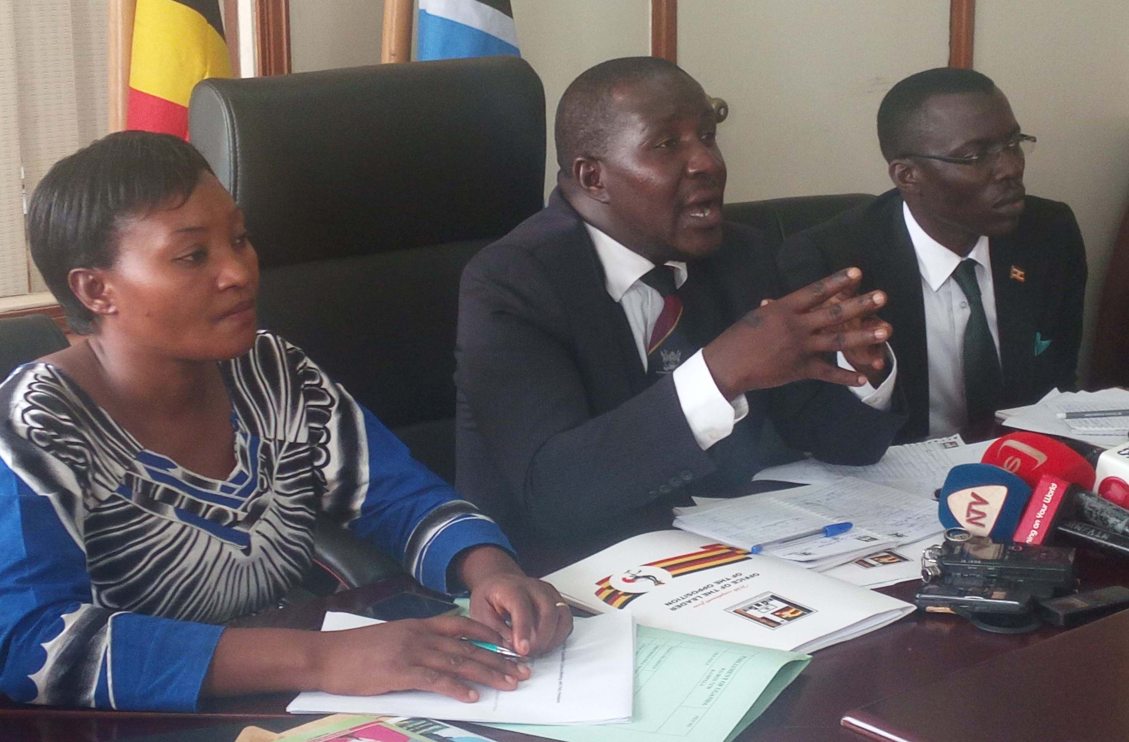 PIC: Asuman Basalirwa - JEEMA president (center), Winnie Kiiza - Leader of Opposition (left) and Gerald Siranda DP (right)
