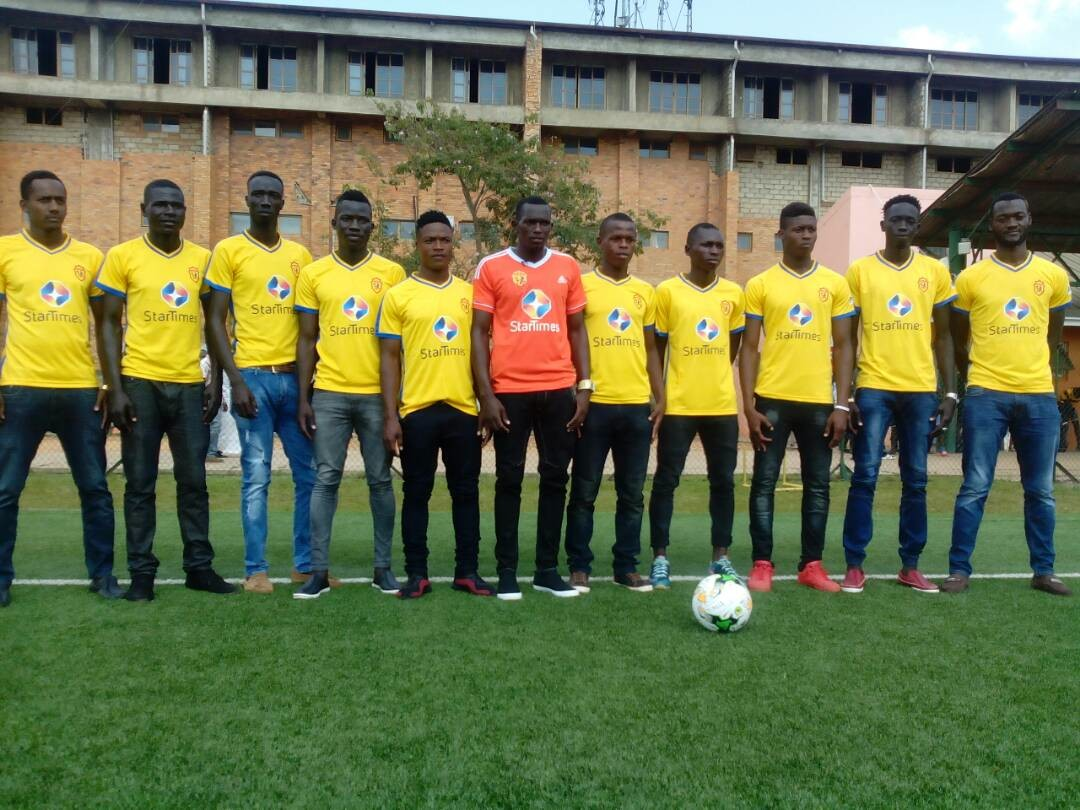 Pic 2. The new KCCA FC players in a group photo at the StarTimes stadium in Lugogo.