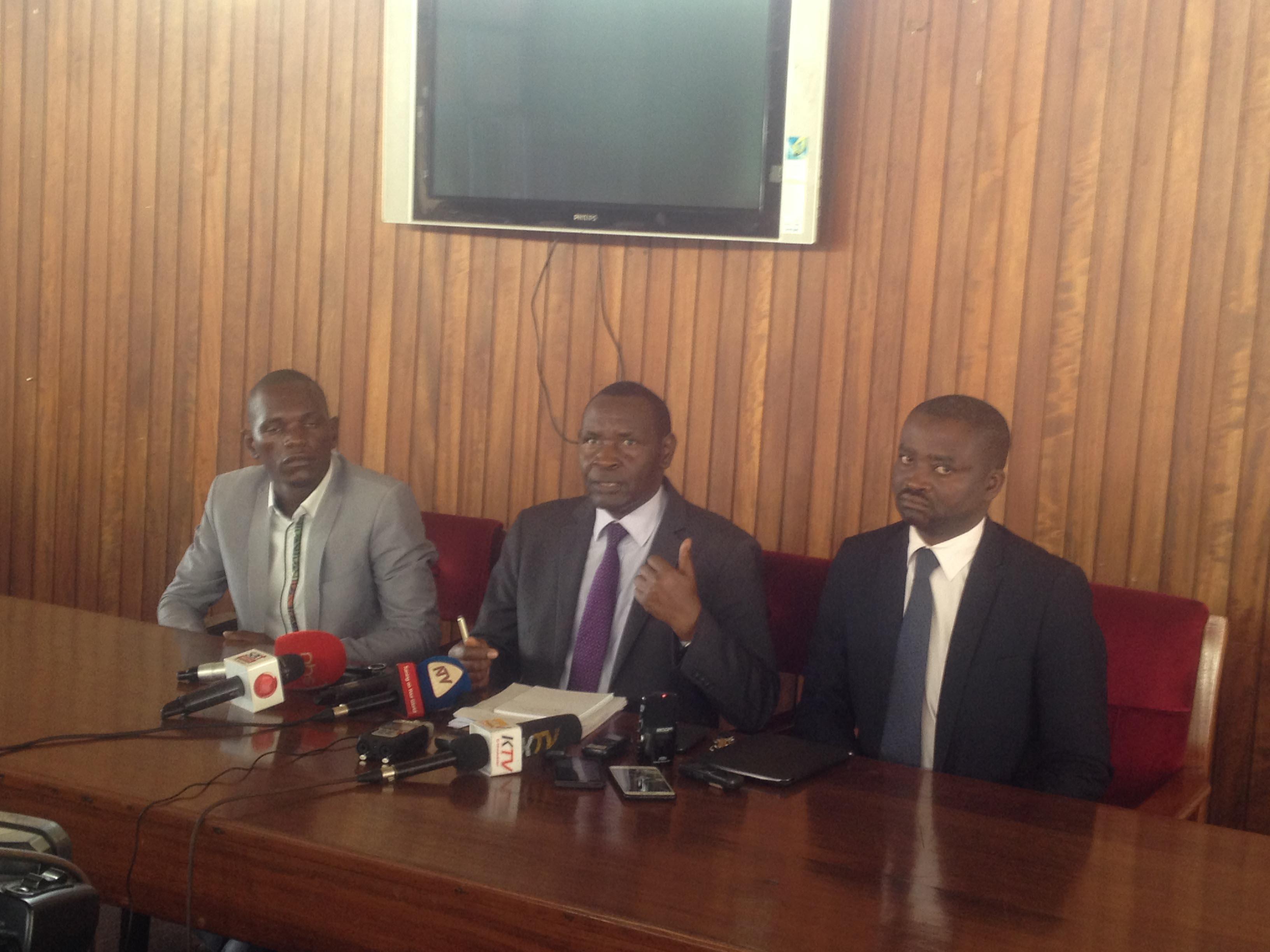 MPs Geoffrey Dhamuzungu, Alex Byarugaba and Silas Aogon at Parliament today. Photo by Beatrice Leni.