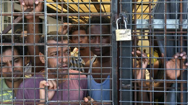 Detainees in the hot houses which are Libya's migrant detention centres. Food and conditions are appalling inside. BBC photo.