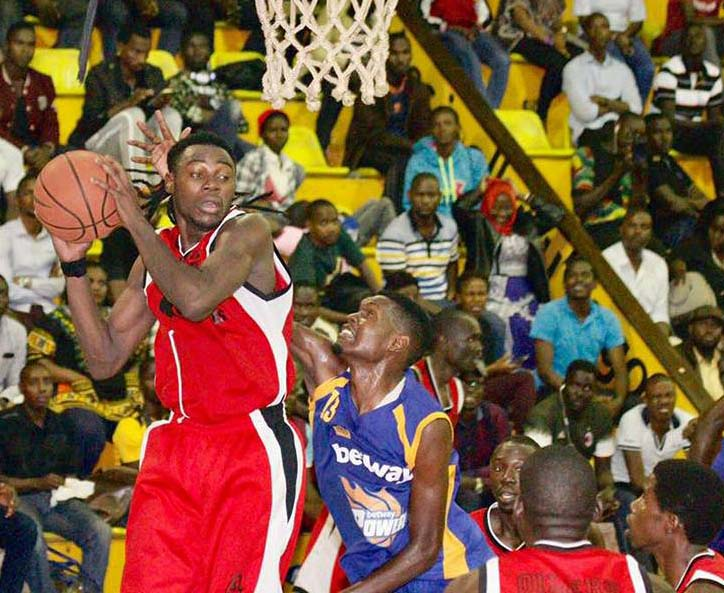 Power's Micheal Makiadi(right) trys to stop Oliers' Landry Ndikumana from converting a jump shot on Friday evening.