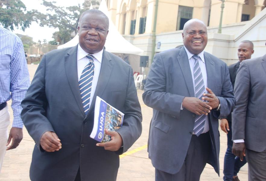 Justice minister Kahinda Ofafiire (left) with Principal Judge Yorokamu Bamwine